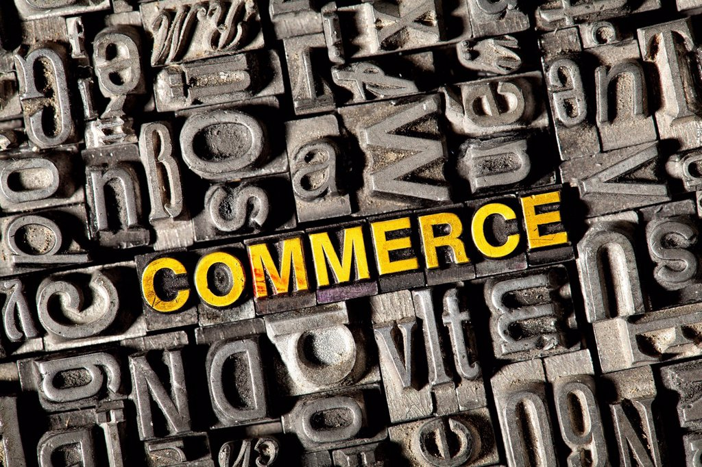Old lead letters forming the word COMMERCE : Stock Photo