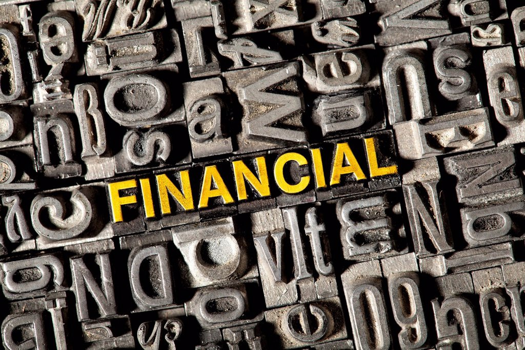 Stock Photo: 1848-744282 Old lead letters forming the word FINANCIAL