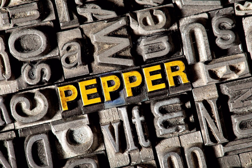 Stock Photo: 1848-744298 Old lead letters forming the word PEPPER