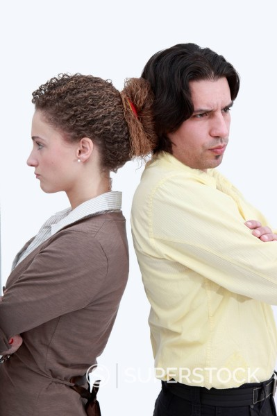 Stock Photo: 1848-744947 A man and a woman standing back to back