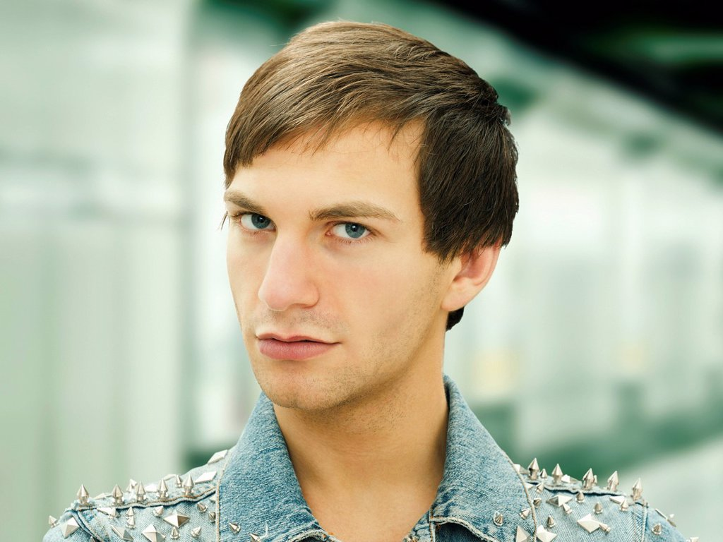 Stock Photo: 1848-745113 Young man with a serious face wearing a studded denim jacket, portrait