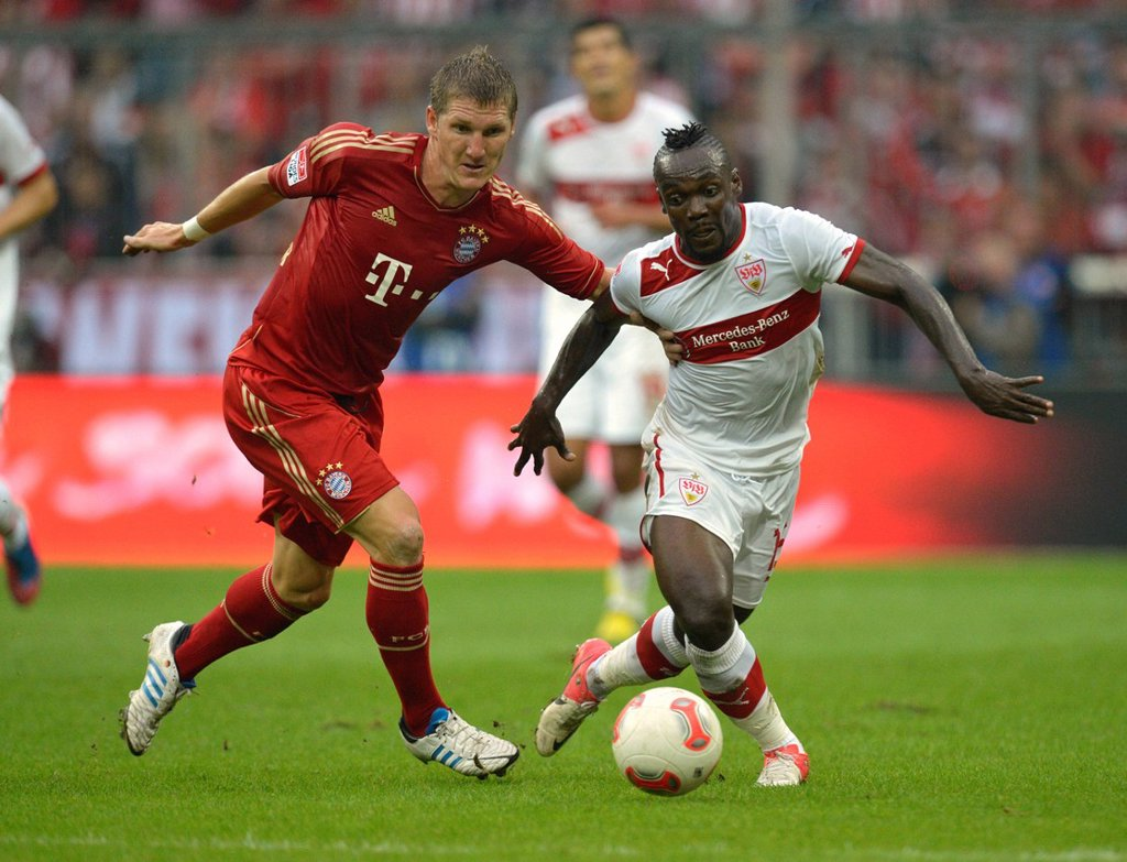 Arthur Boka of VfB Stuttgart, right, in a duel with Bastian Schweinsteiger of FC Bayern Munich, left, Allianz Arena, Munich, Bavaria, Germany, Europe : Stock Photo