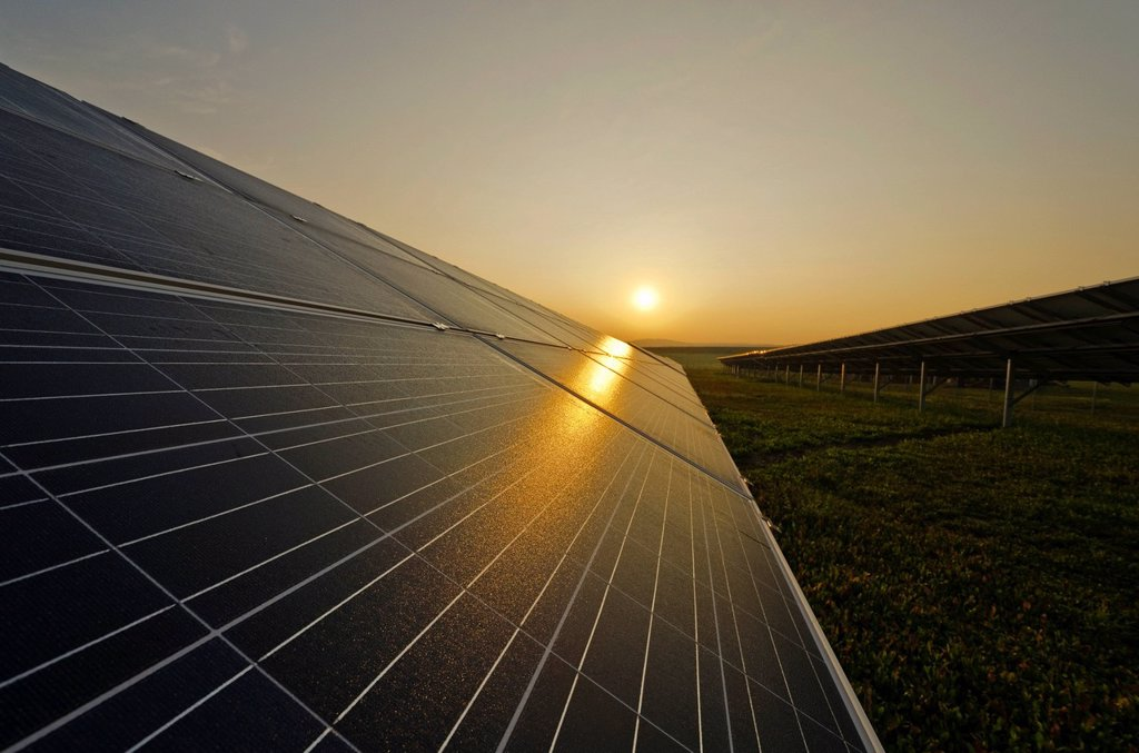 Photovoltaic power plant, at sunrise, Nentmannsdorf, Saxony, Germany, Europe : Stock Photo