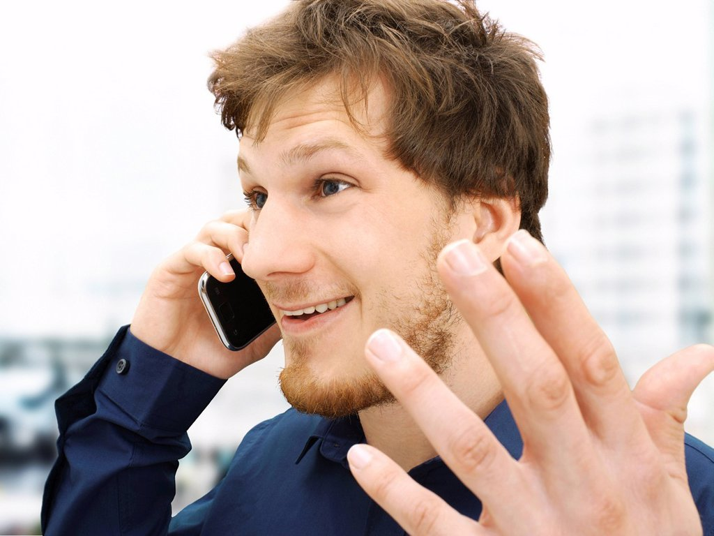 Stock Photo: 1848-746288 Portrait of a businessman making a telephone call, gesticulating, friendly, optimistic