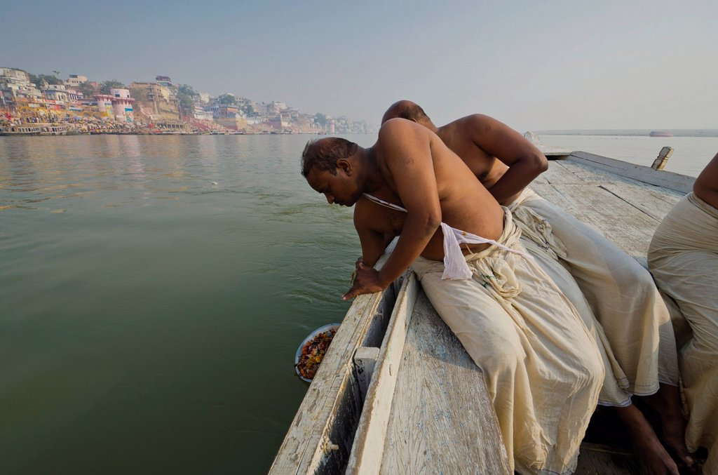 Stock Photo: 1848-747119 Remains of the cremation of a family member are offered to the holy river Ganges, Varanasi, India, Asia
