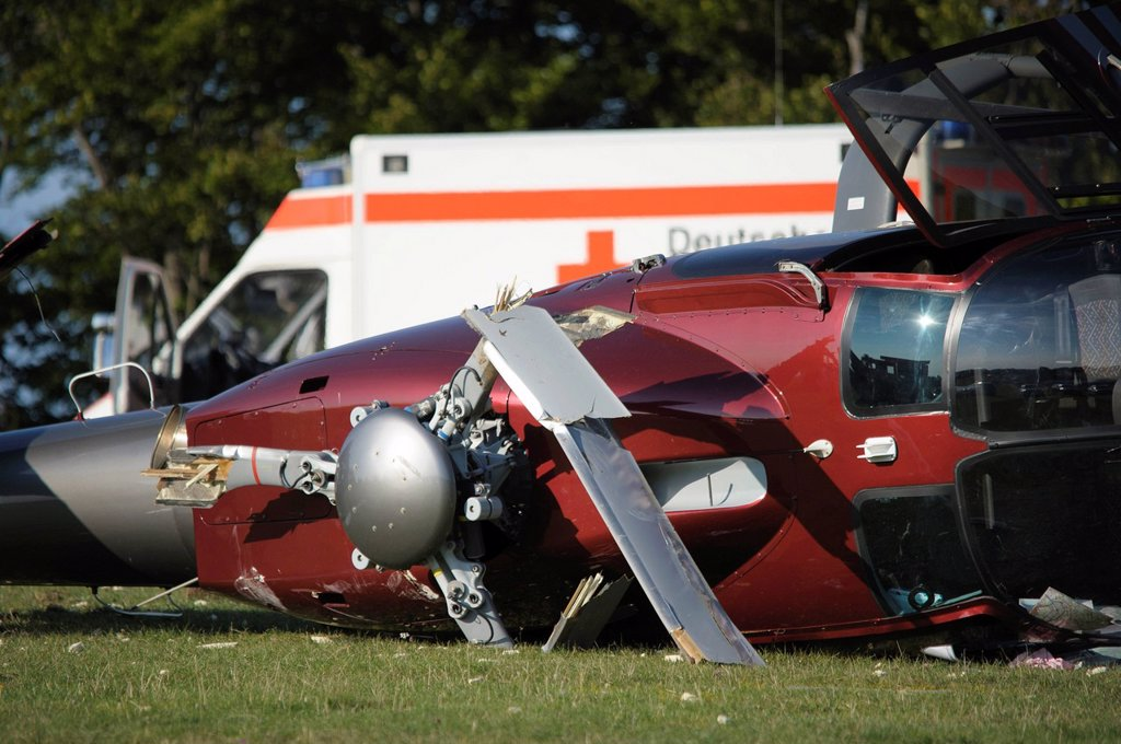 A crashed EC 120 helicopter, an ambulance standing at the back, Metzingen, Baden_Wuerttemberg, Germany, Europe : Stock Photo