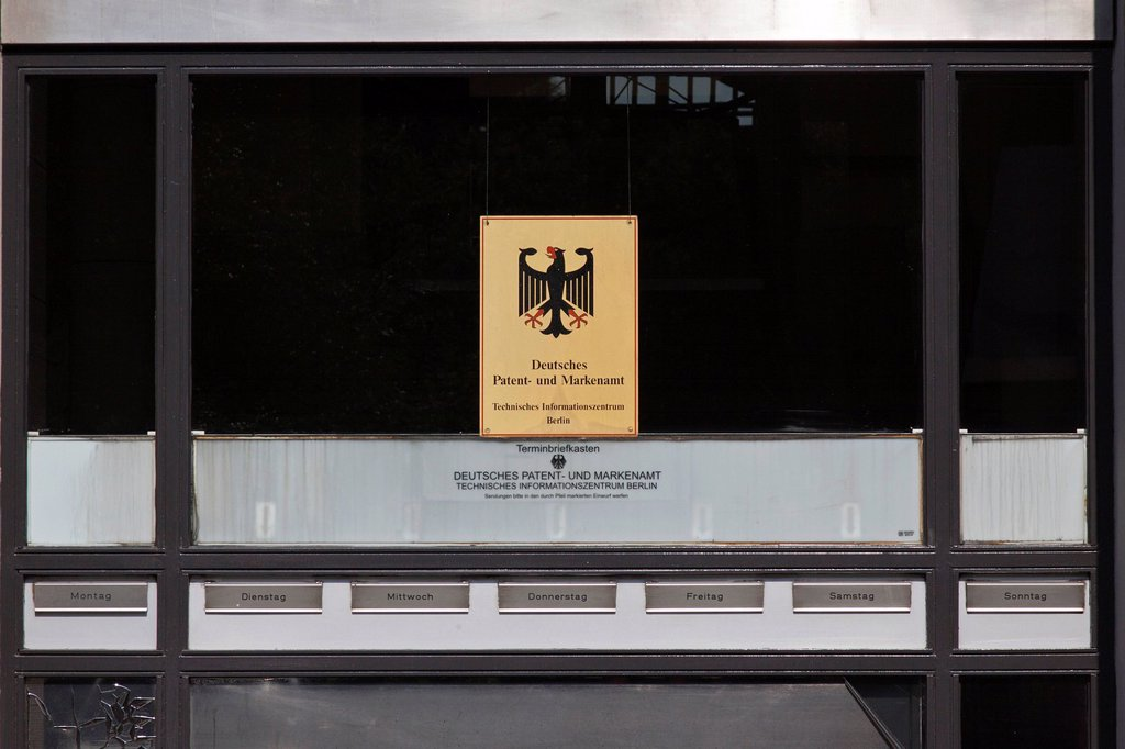 Sign, dirty window, lettering Deutsches Patent_ und Markenamt, German for German Patent and Trade Mark Office, with one mailbox for each day of the week, Berlin, Germany, Europe : Stock Photo
