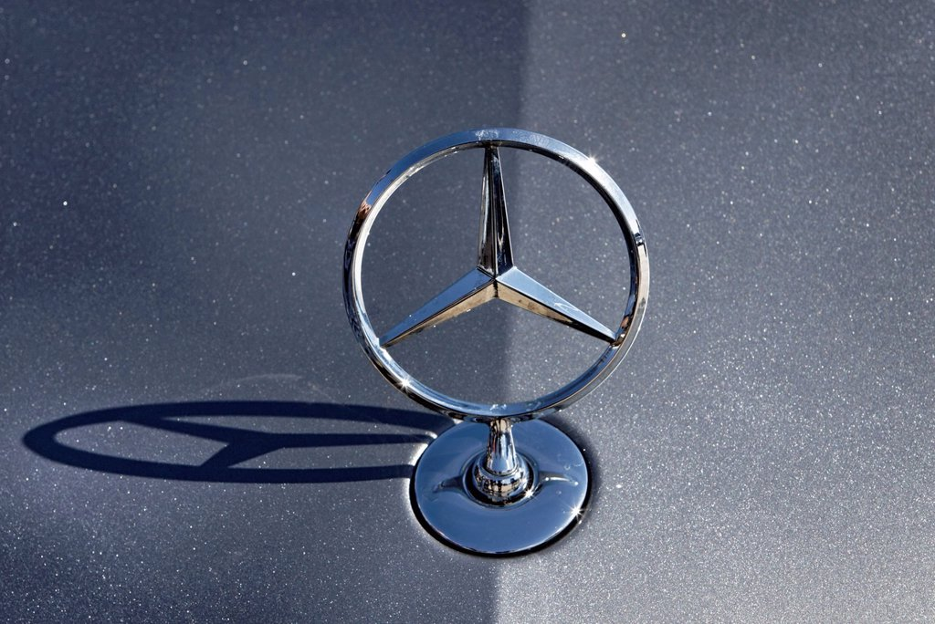 Star of Mercedes_Benz on the hood of a new E_Class car in Stuttgart, Baden_Wuerttemberg, Germany, Europe : Stock Photo