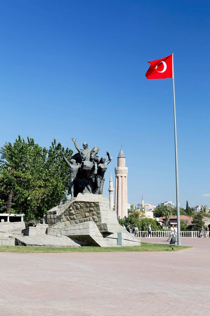 Statue of Mustafa Kemal Ataturk with the Turkish flag in front of the Yivli Minare Mosque in the historic town centre of Antalya, Kaleici, Turkish Riviera, Turkey, Asia : Stock Photo