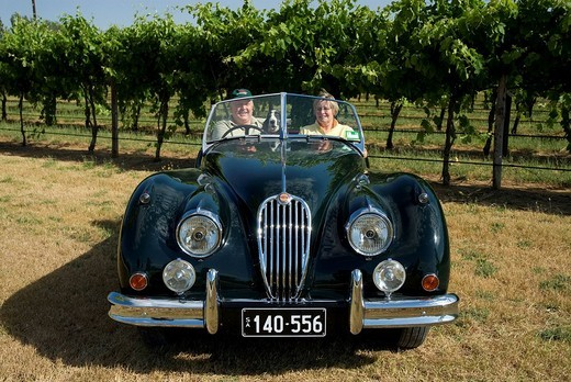Stock Photo: 1848-75697 James and Anne Yates, owners of the Chardonnay Lodge in their Jaguar XK 140 built in 1954, Coonawarra, South Australia, Australia