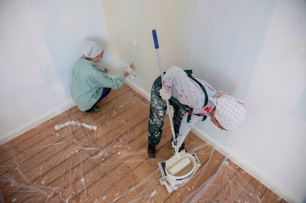 Stock Photo: 1848-757652 Mother and daughter renovating a room, painting the walls with paint rollers