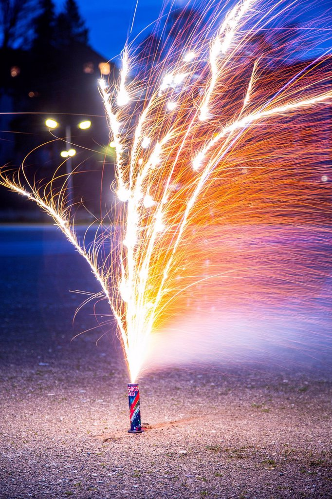 Stock Photo: 1848-761214 Burning of a New Year's Eve firework