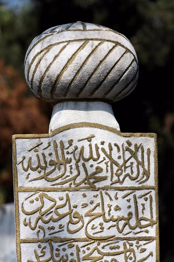 Stock Photo: 1848-77035 Traditional Muslim tombstone with a stylized turban and Arabic characters, Eyuep village, Golden Horn, Istanbul, Turkey