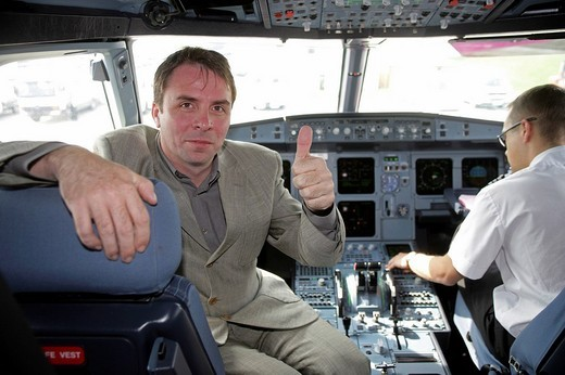 Wizz Air CEO József Váradi at the Cockpit of an Airbus A 320 : Stock Photo