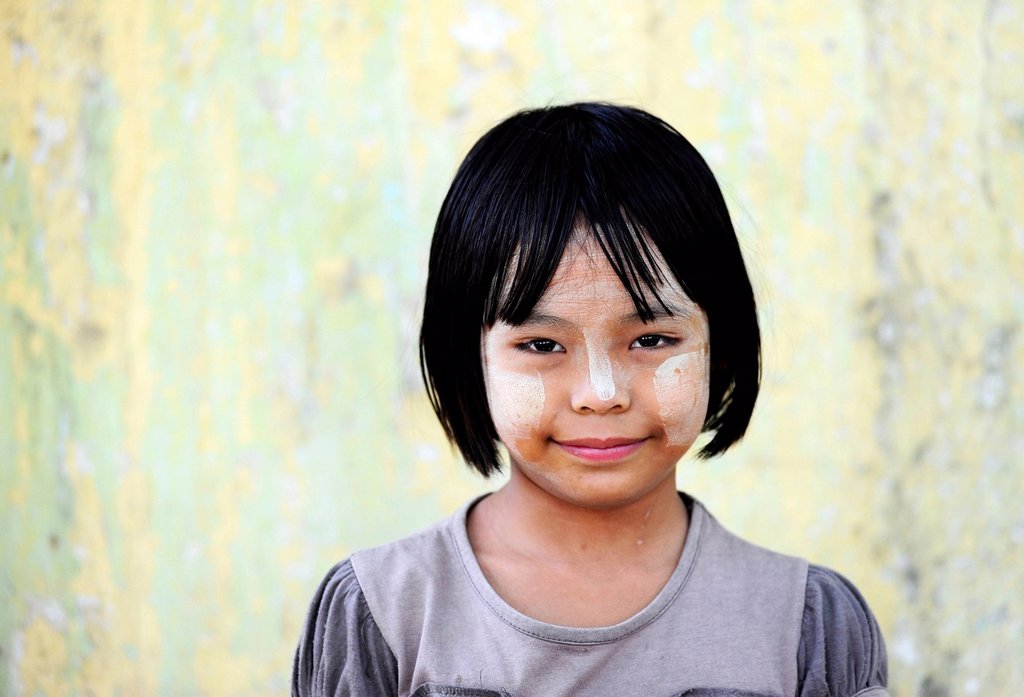 Stock Photo: 1848-797906 Girl with thanaka paste on her face, Mandalay, Myanmar, Burma, Southeast Asia, Asia