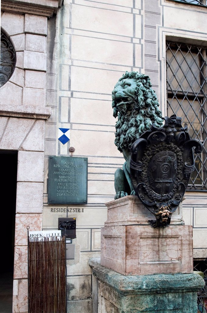 Stock Photo: 1848-799499 Lion sculpture in front of the Munich Residence, Residenzstrasse 1, the lower lip of the lion looking polished as it is rubbed for good luck, Munich Bavaria, Germany, Europe