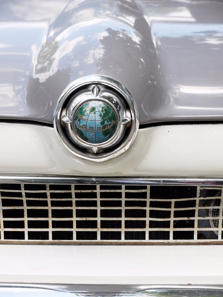 Stock Photo: 1848-802437 Emblem of a Ford Taunus classic car with a globe