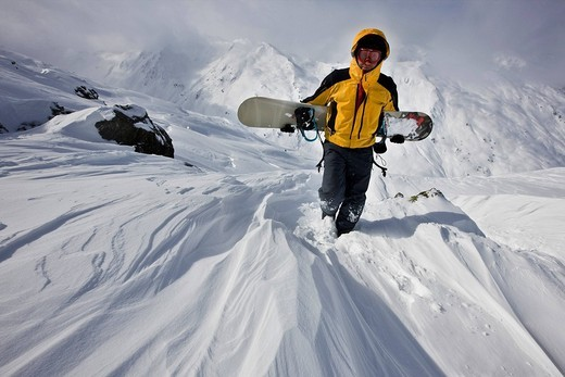Snowboarder in deep snow, Hochfuegen, Tux Alps, North Tyrol, Austria, Europe : Stock Photo