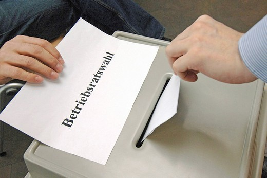 Workers council election _ droping an envelope in a ballot box : Stock Photo