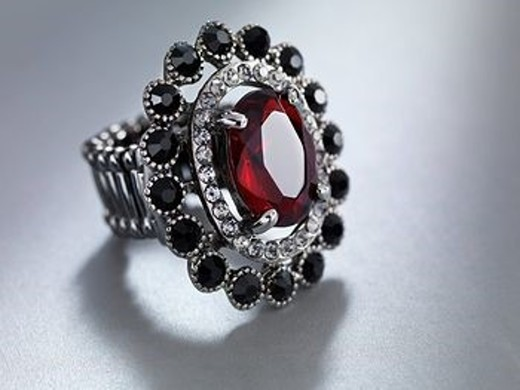 Ring with red stone : Stock Photo