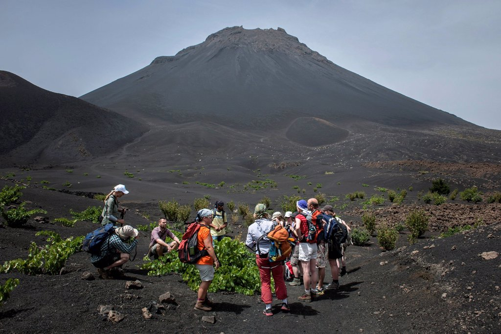 Hikers in front of the volcano Pico do Fogo, Fogo National Park, Fogo island, Cape Verde : Stock Photo