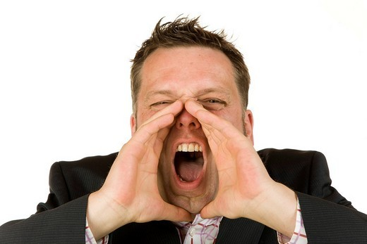 40 year_old businessman shouting : Stock Photo