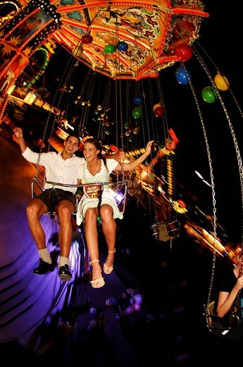 Oktoberfest Beer Festival, Wies´n, couple on the chairoplane, Munich, Bavaria, Germany, Europe : Stock Photo