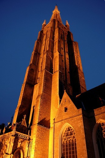 Illuminated tower of the Church of Our Lady, Bruges, Belgium, Europe : Stock Photo