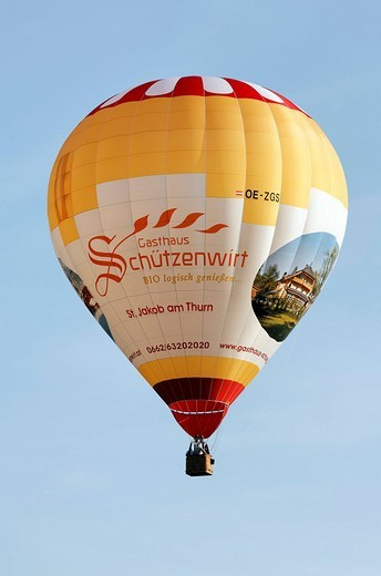 Hot air balloon with advertising for a restaurant with organic cooking, Flachgau, Salzburger Land region, Salzburg, Austria, Europe : Stock Photo