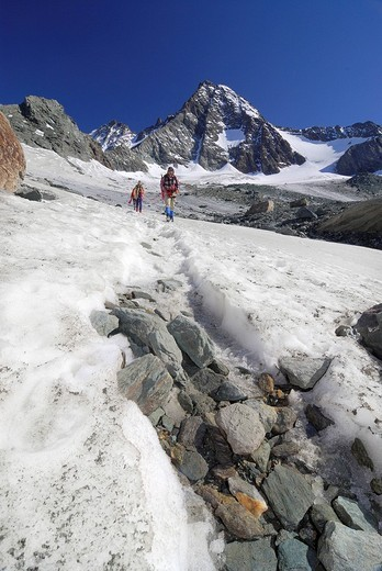 Snow covered trail in front of the peak of the Grossglockner, National Park Hohe Tauern, Tyrol, Austria : Stock Photo