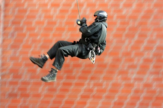 Stock Photo: 1848-83677 DEU, Germany, NRW : SWAT team in a training situation, roping. ,