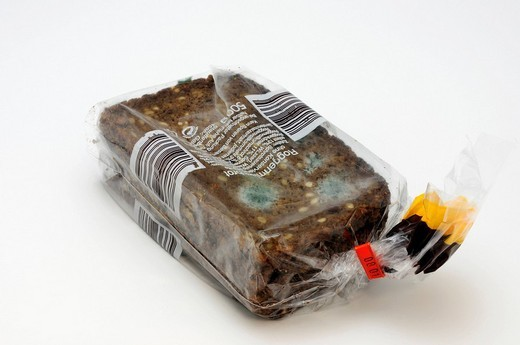 Bag of moldy dark bread : Stock Photo