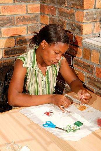 Bead embroiderer producing Christmas decorations, Cape Town, South Africa : Stock Photo