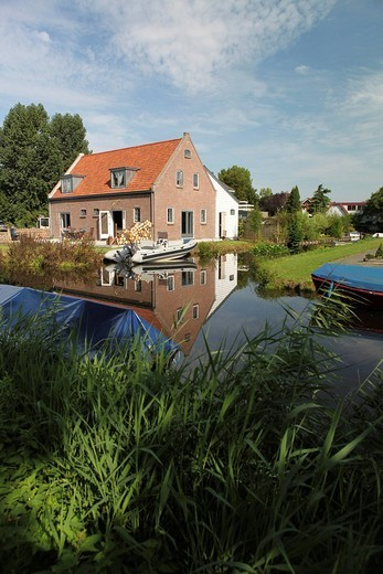 Stock Photo: 1848-87230 Traditional Dutch countryside family house by the canal, Landsmeer village near Amsterdam, Netherlands, Europe