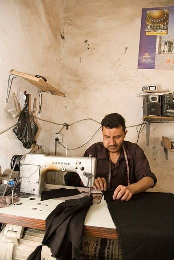 Stock Photo: 1848-88352 Tailor using a sewing machine, tailor shop, San'a', Yemen, Middle East