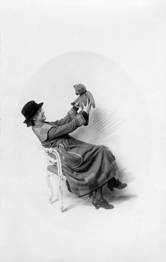 Historic photo, woman with teddybear, ca. 1920 : Stock Photo