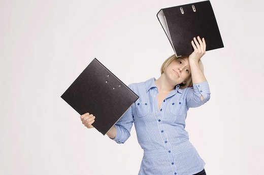 Young woman holding files : Stock Photo