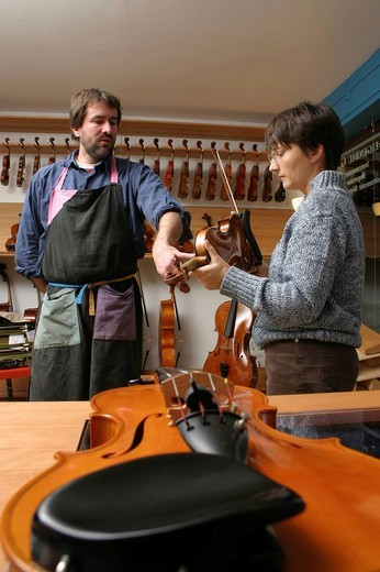 Stock Photo: 1848-91941 Violin_maker luthier with a customer in his shop