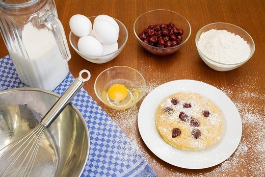 Cherry pancakes and ingredients : Stock Photo