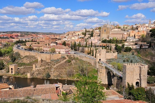 View of the old part of Toledo and the Tajo River, Puente de San Martín in the foreground, Toledo, Spain : Stock Photo