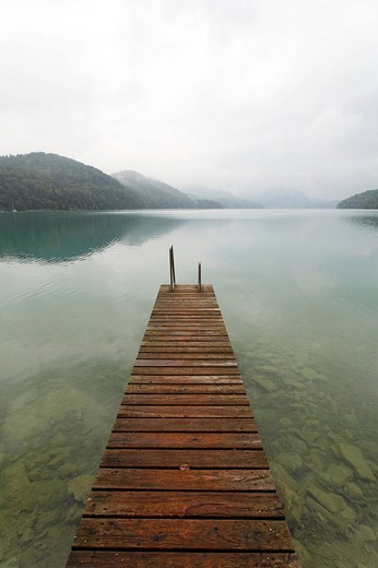 Wooden jetty juts into the Fuschlsee lake, overcast sky, rainy, dreary atmosphere, Salzkammergut area, Salzburger Land region, Salzburg, Austria, Europe : Stock Photo