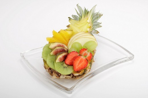 Colourful fruit salad in a baby pineapple : Stock Photo