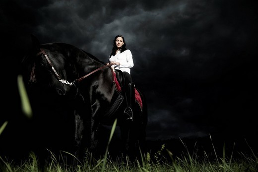 Young woman riding her horse : Stock Photo
