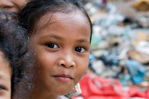 Portrait of a girl at a rubbish dump, Dey Krahom slum area, Phnom Phen, Cambodia : Stock Photo