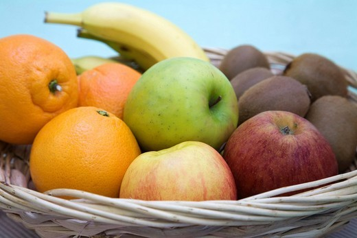 Stock Photo: 1848-96005 Detail of a fruit basket with oranges, apples, banana and kiwis