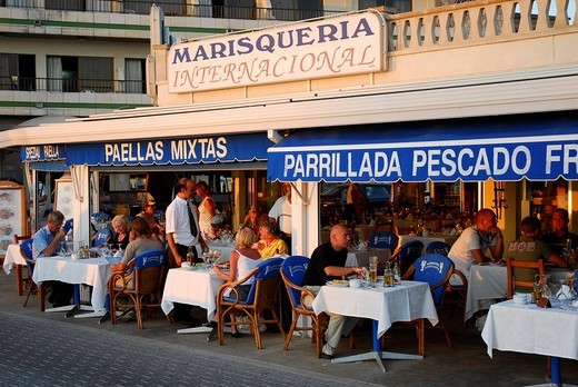 Marisqueria Internacional in the evening light, a seafood restaurant with a terrace on the street in Can Pastilla, Majorca, Balearic Islands, Spain, Europe : Stock Photo