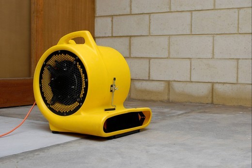 Stock Photo: 1848-96503 Carpet cleaner´s air blower drying a flooded room