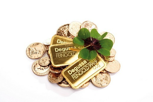 Gold bars, four_leaf or lucky clover and coins : Stock Photo