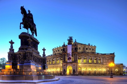 Stock Photo: 1848-98781 Semperoper Opera house with flags and illuminated at night and Koenig Johann memorial, Theaterplatz square, Dresden, Free State of Saxony, Germany, Europe