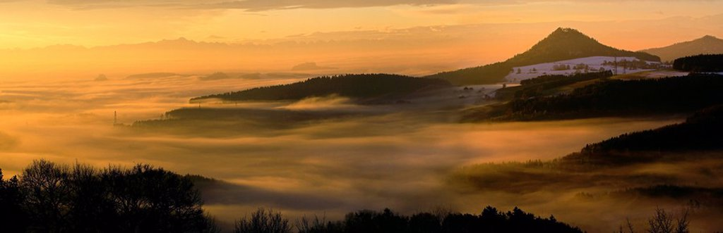 View from Hegaublick across the fog_shrouded valleys to the Swiss Alps, Hohenheven on the right, Switzerland, Europe : Stock Photo